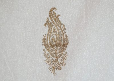 The Chameli range features a gold print on an off-white background with a pure white texture print.